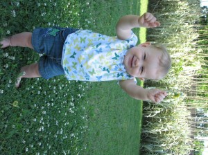 I love this outfit and the picture =)  She loves playing with nature =)