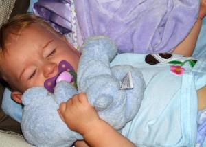 Sometimes when she wakes up she roars and holds up her bear =)