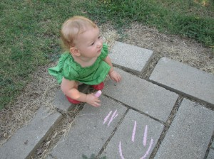 Those toddler crayons didn't work so well for her, but she had fun with the chalk!