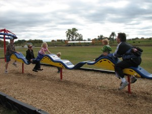 We met Mike, Kelly, Raegan and Carson at the park.  This has to be the craziest teeter-totter ever!  So fun =)