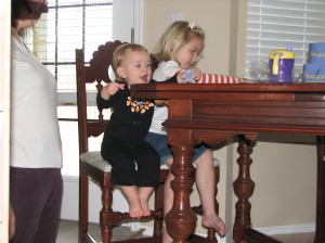 Serenity was SO excited to sit by Raegan... and she very helpfully kept knocking all the puzzle pieces to the floor.