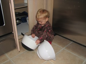 Serenity loves pulling the bowls out of the cabinet, it's almost as much fun as her spoon drawer!