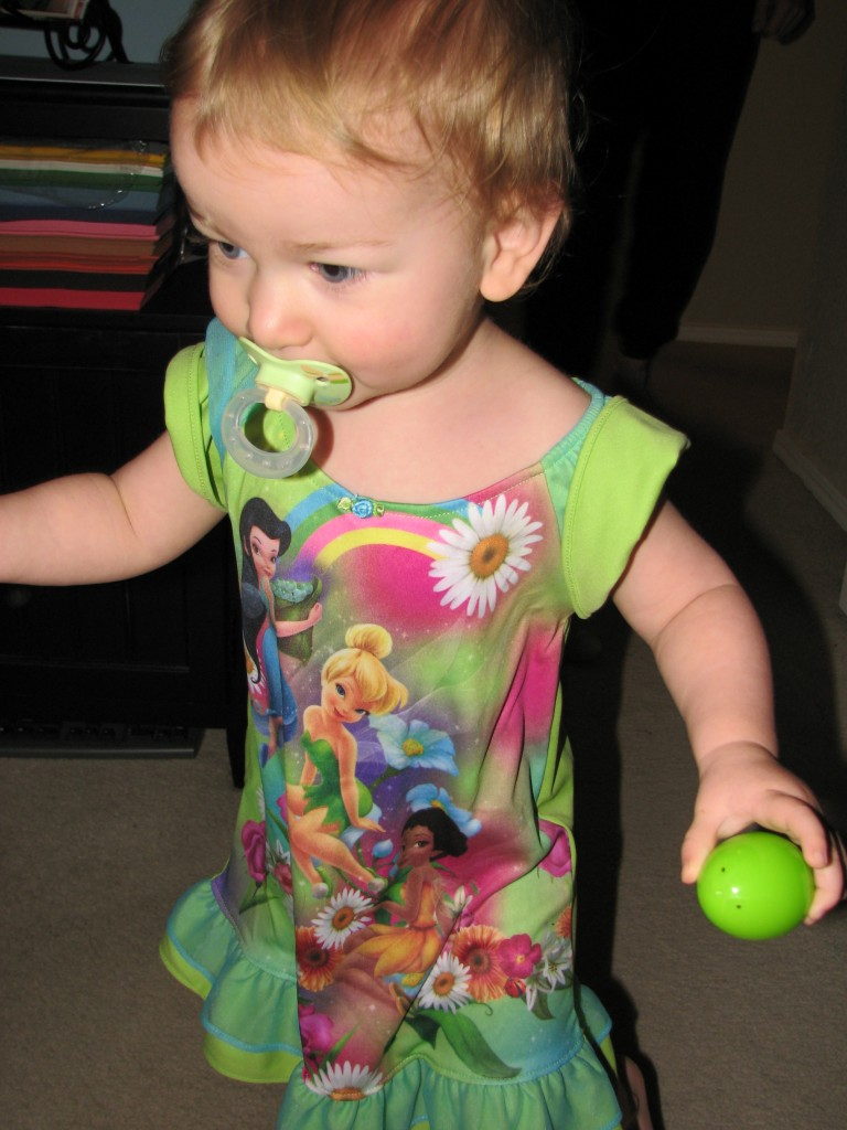 Wearing the Tinkerbell nightgown =)  The first thing she wanted to wear was her whale pajamas, and the next morning she wanted to dress in her heart pajamas =)
