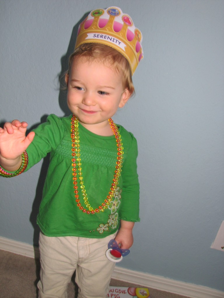 "Here she is modeling her necklaces, bracelet, and her ""golden crown"" that we printed off a Super Why game at pbskids.org.  Yes, I have now started playing computer games with her, which means every time I get on the computer now she says, ""click on Super Why!!!"" =)"