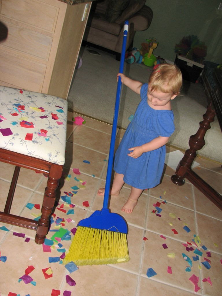 Sweeping up the super fun confetti =)