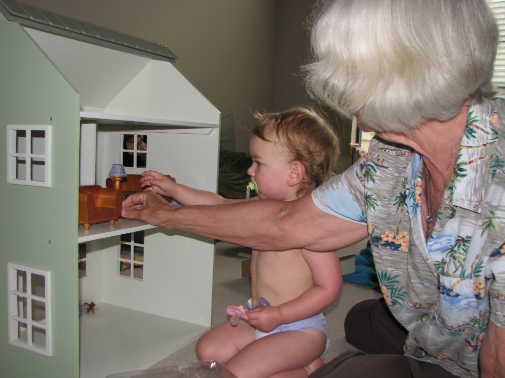 Ann got Serenity this amazing doll house!  Serenity has started putting her super readers in it.  And sometimes she likes to put the little doll to bed on the coffee table, since she just has living room furniture so far. =)