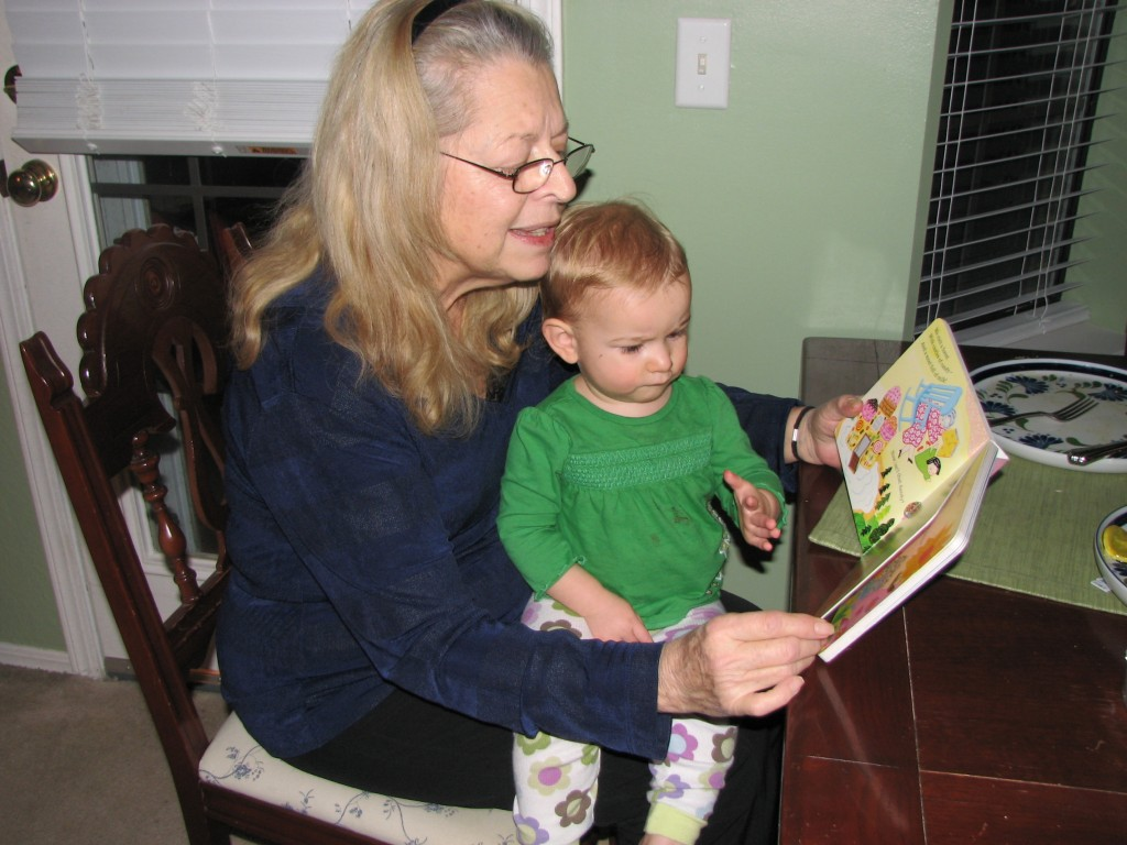 "Grandma reading ""In Grandma's Arms"""