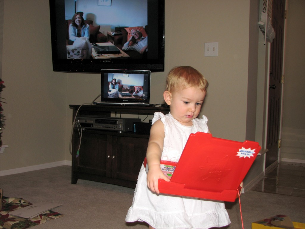 She wanted to play as soon as she opened it!  Here we're skyping with Cupertino on Christmas Eve =)