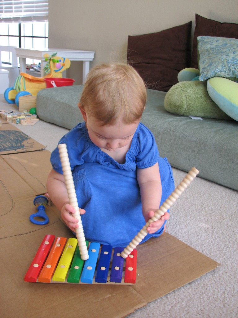 She's tapping the sticks like we do at Music Class =)