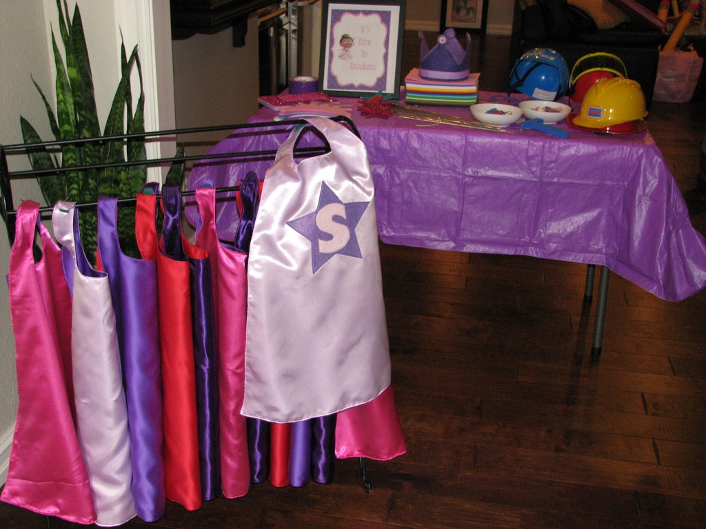 I made capes for everyone, and got lots of stickers and accessories so everyone could customize their superhero!