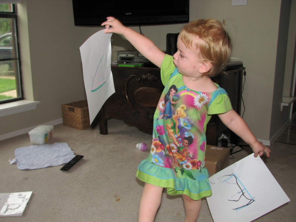 One day when she wanted to do crafts I wrote letters for her to trace =)  She loved the letters and ran around the house waving them in the air!