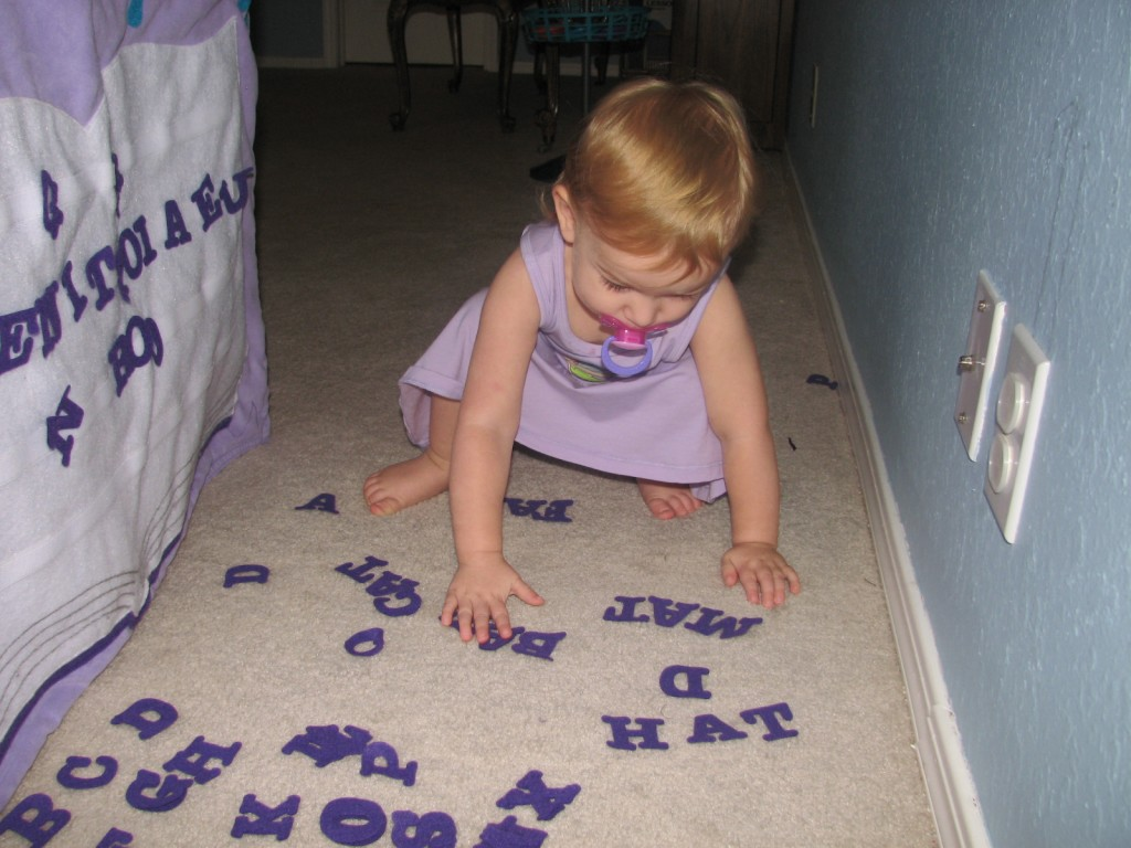 She loves spelling with her new felt letters in her Book Club =)  She's doing all the -at words she can think of =)