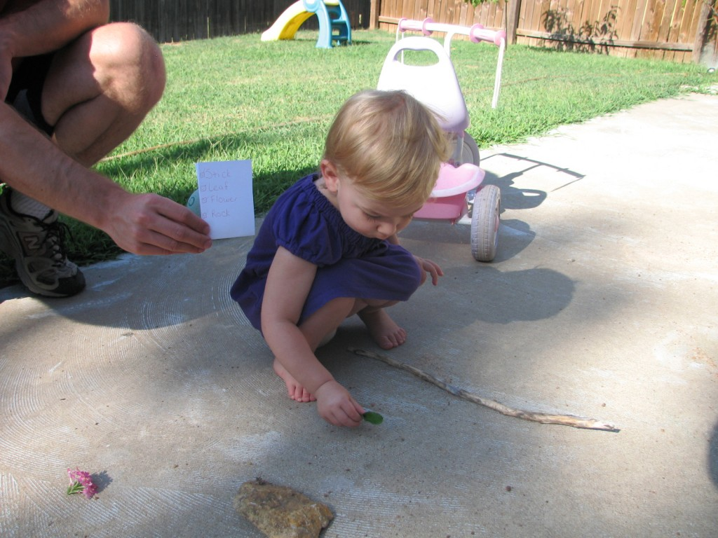 Serenity's First Scavenger Hunt!  I wrote the words Stick, Leaf, Flower, and Rock on a paper, and Serenity read each word by herself and then went to find each object!