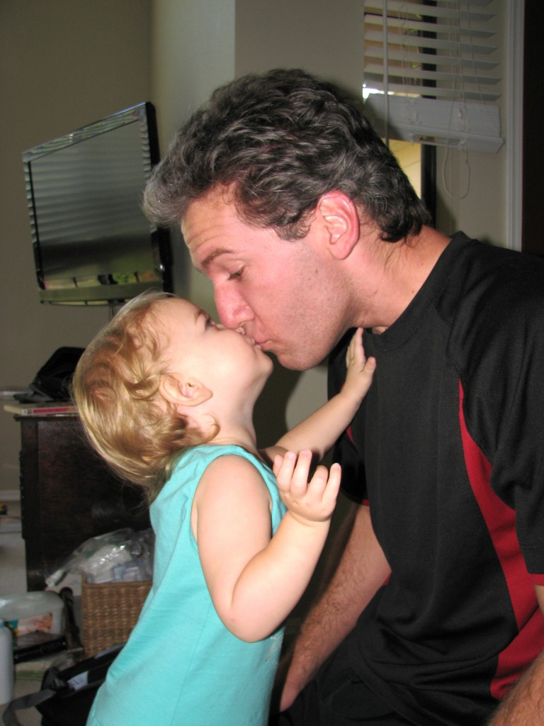 Serenity gives Daddy a kiss AND a hug every day before work =)