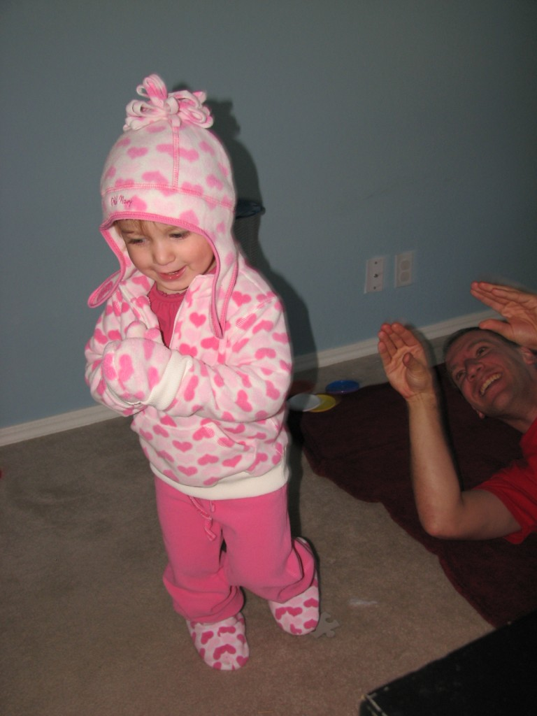 Trying on some hand me down winter clothes from Raegan =)  She loves the gloves this year!