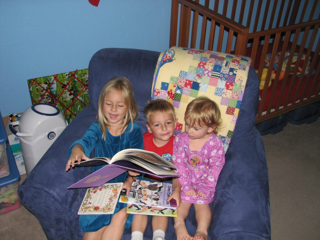 All three kids piled into the rocker and Raegan read to them =)