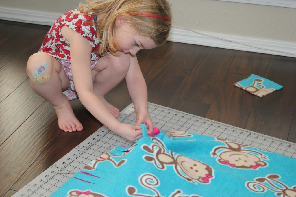 She picked this monkey fabric for the donation blanket.  So cute!