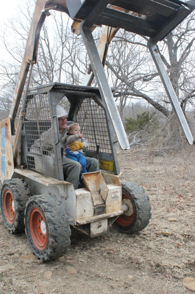 "Donovan was very emphatic that he get a turn on the bobcat too.  =)  He was not sure that Daddy should get a turn, he kept saying ""Casey do it!"""