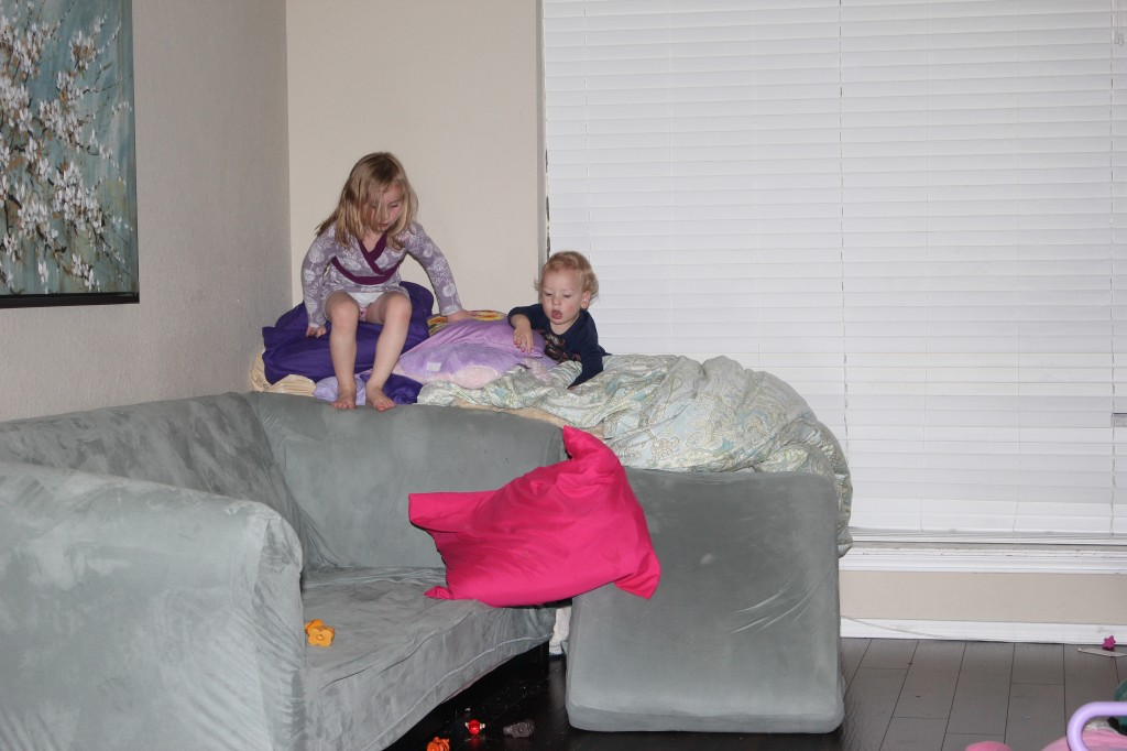 One of their favorite games right now is making huge constructions using every pillow and blanket in the house.  They spend a lot of time working together on this!  I love that part... not so much when I am putting it all back. =)