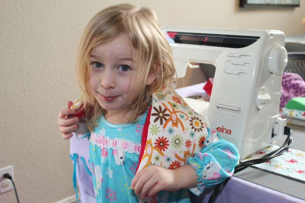 We try to do an activity for kindness day every Friday.  Serenity helped to sew and fill corn bags for Grandma and Little Casey. She's very careful with the sewing machine.
