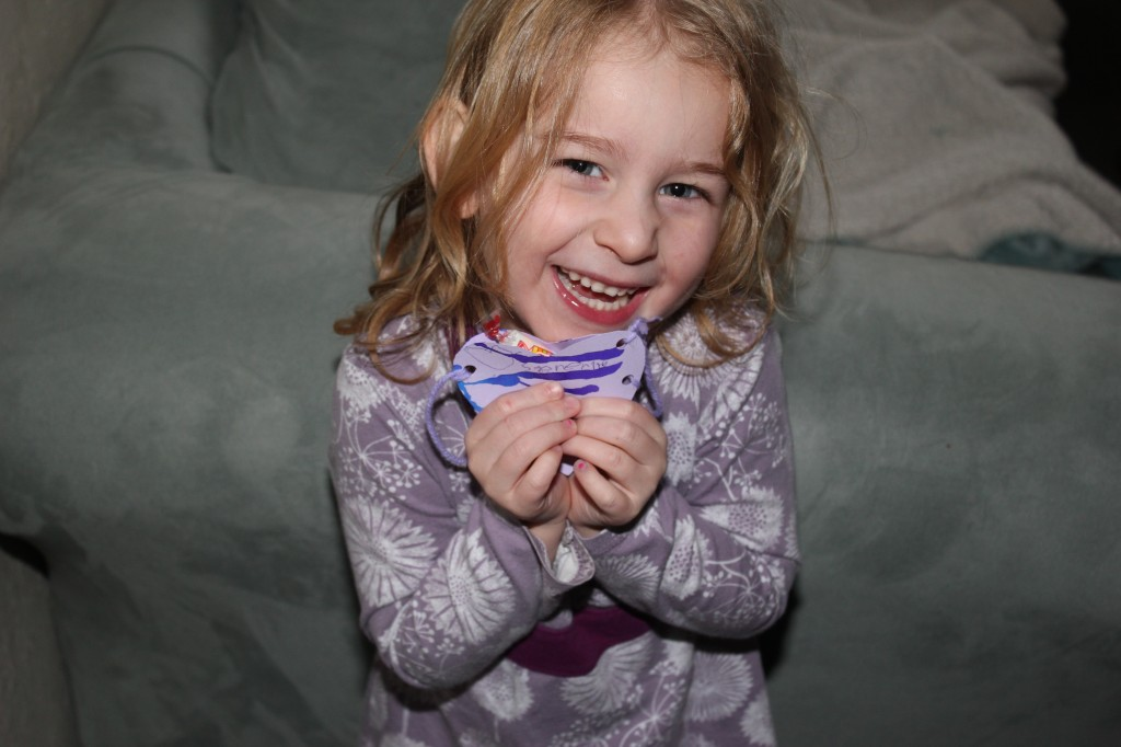 We made her valentines this year =)  Cut out the hearts, used liquid watercolors and droppers to paint them, and then sewed them together into necklaces!  It took several steps, I was so proud!
