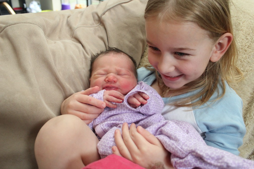 Maia's first day home.  She was so much smaller!  Very happy Big Sister =)