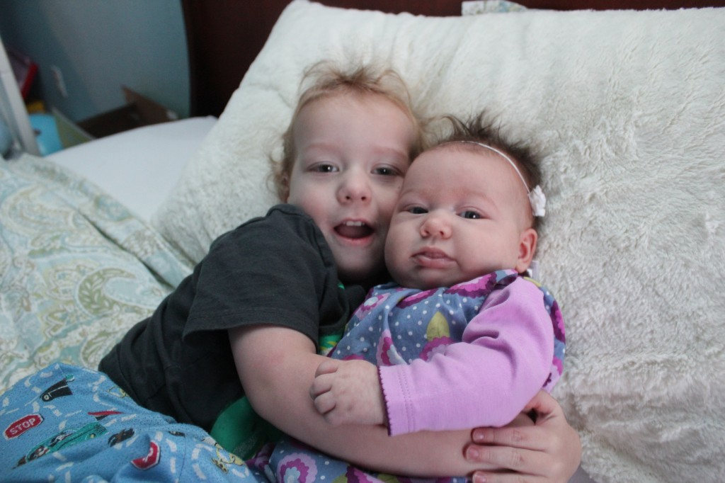 Snuggling with brother =)  He watches out for her already =)