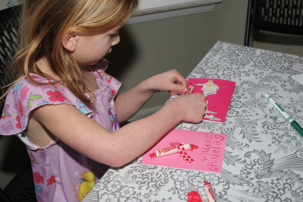 Serenity spent a lot of time making Valentines for each of her classmates!  I had bought blank cards and she used up all the stickers in the sticky tub to make them fancy!  And we added smarties to them =)