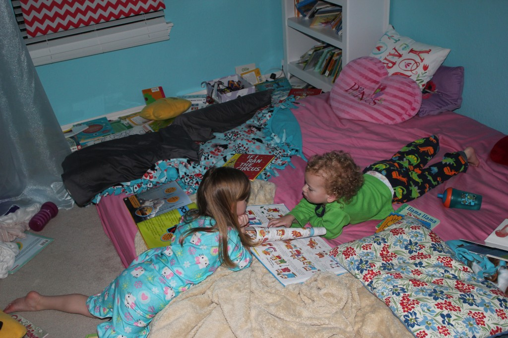 Reading the Best First Book Ever together.  They still love choosing characters on each page to be.