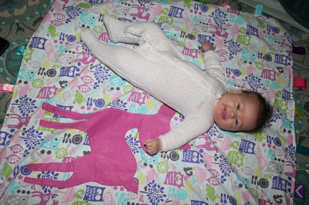 Maia and her taggie deer blankie I made her.  With help from Donovan =)