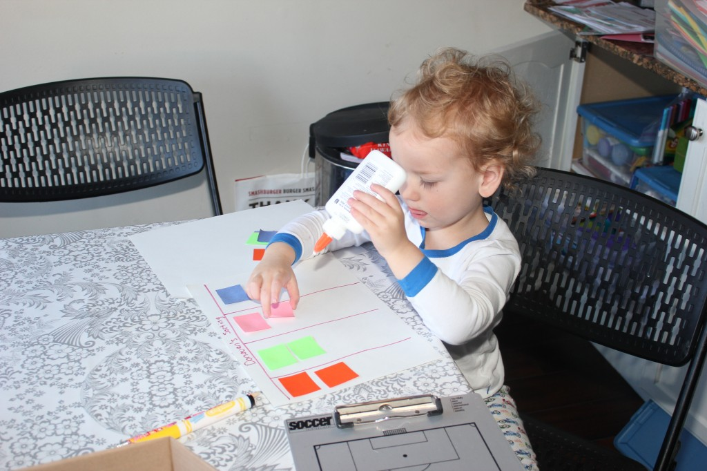 His first experience with regular glue =)  He sorted colored squares and glued them down.   He liked this so much we did it several more times that week