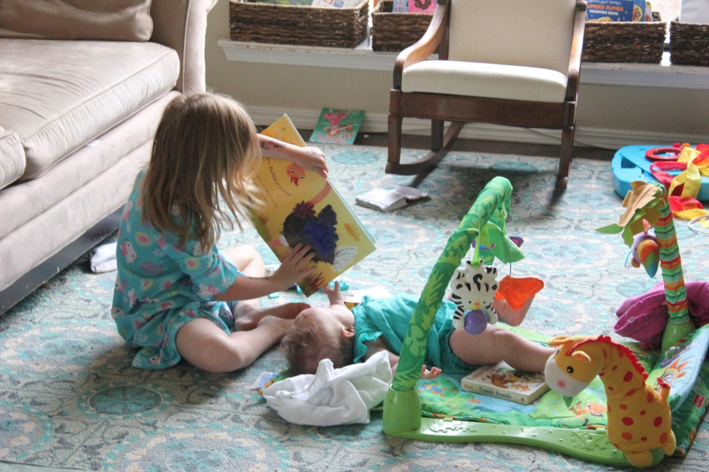 Reading to Maia.  She is a great big sister... At least until she decides to give Maia another headstand lesson.