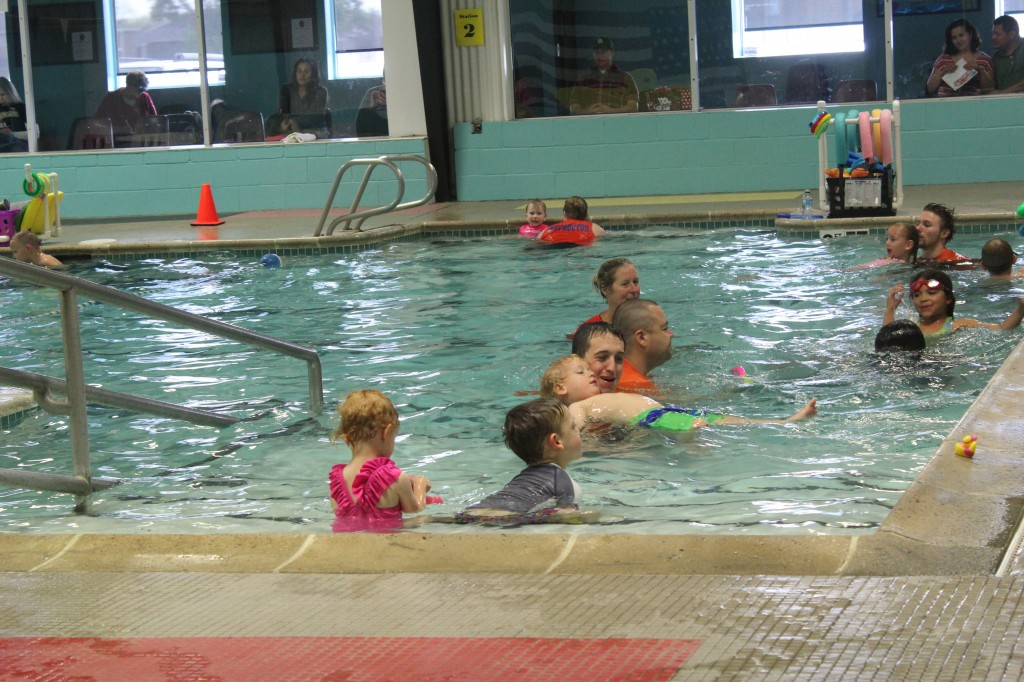 Swimming with his teacher like a big boy!  He was working on arm movements all week. =)