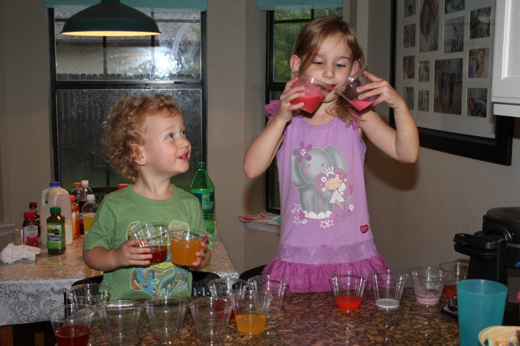 Science experiment with Daddy... they read it in one of our Science books for kids, and Eric surprised them by getting ingredients.  They mixed and tasted various combinations of juices, sodas and other drinks to experiment with flavors and color changes.