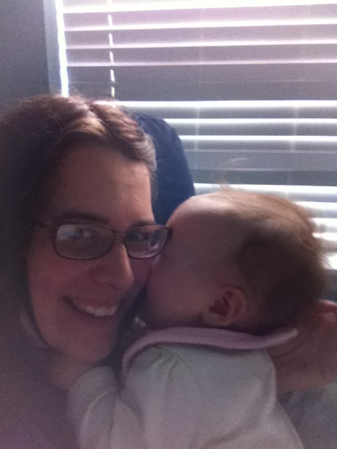 "She gives sweet ""I'm trying to eat your face"" kisses.  While holding onto your hair for dear life =)  Love it!"