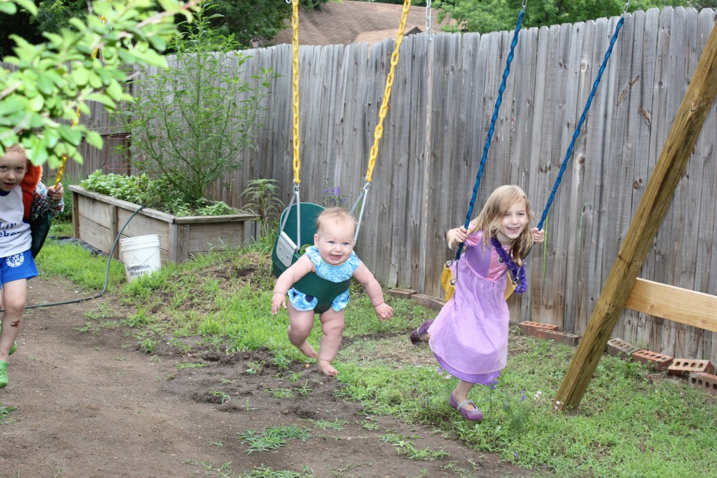 Eric has been taking the kids outside every morning to swing before work =)  Maia gets to participate!