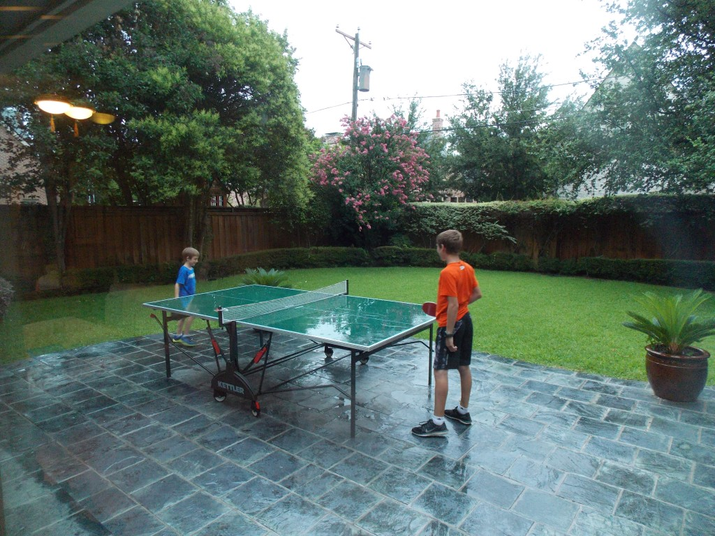Playing Ping Pong in the rain