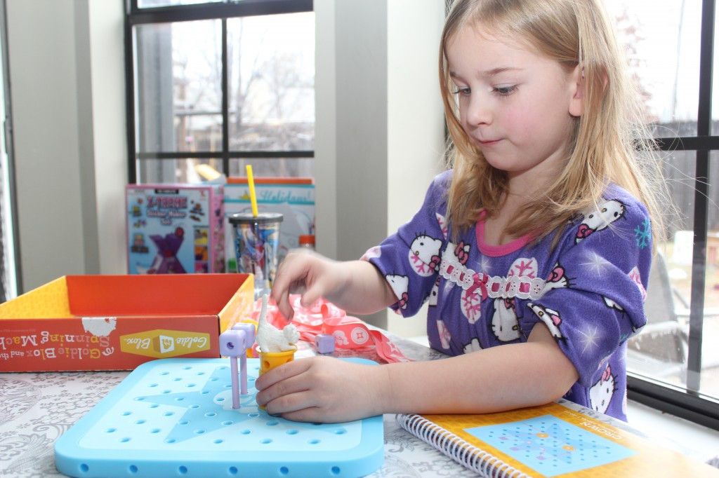 Goldieblox and Legos.  I love the complex building she can do!
