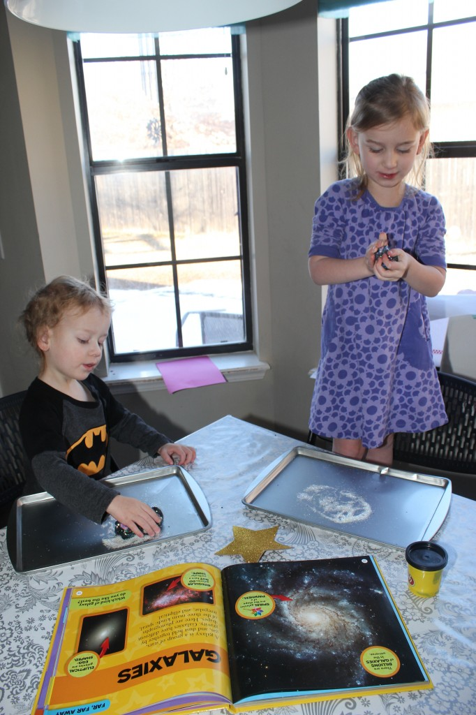 Galaxy Play-doh.  This was one of their favorite crafts this year.  We looked at pictures in Serenity's space book, and added colors and sparkles to black play-doh to make the galaxy.  Serenity added beads for each planet and the asteroid belt!