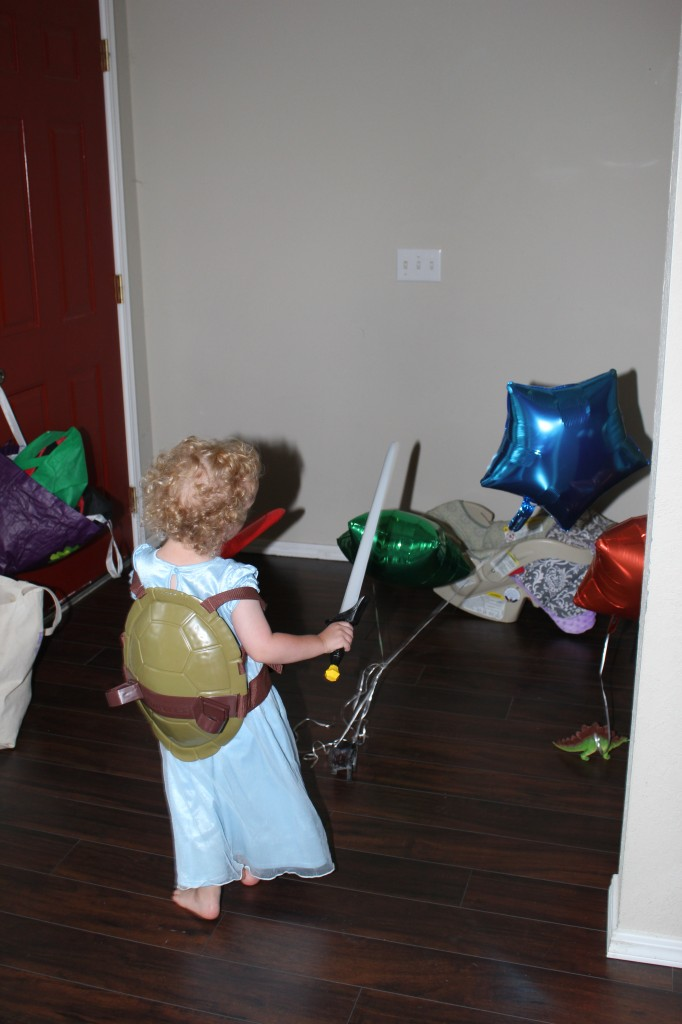 Leonardo attacking balloon foot soldiers with his katanas.  In a princess nightgown.
