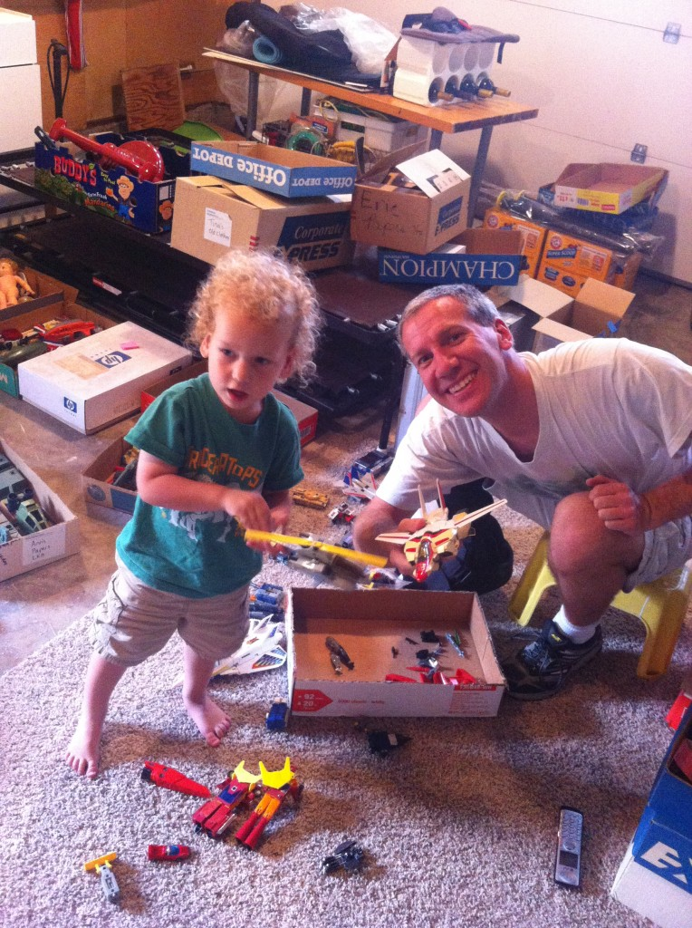 Checking out Daddy's toys from childhood =)  They got to bring home transformers and ninja turtles! =)