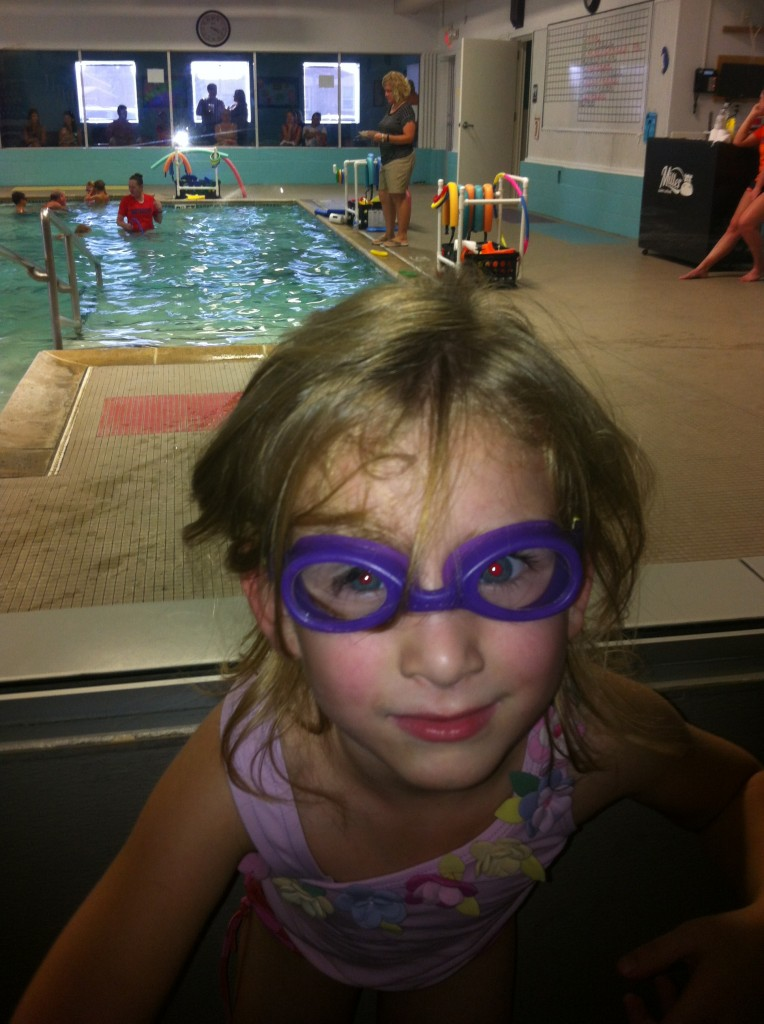 Serenity earned her goggles!  She had asked for them, and Eric said she could have them when she could swim the length of the pool by herself!  And she did it!!!