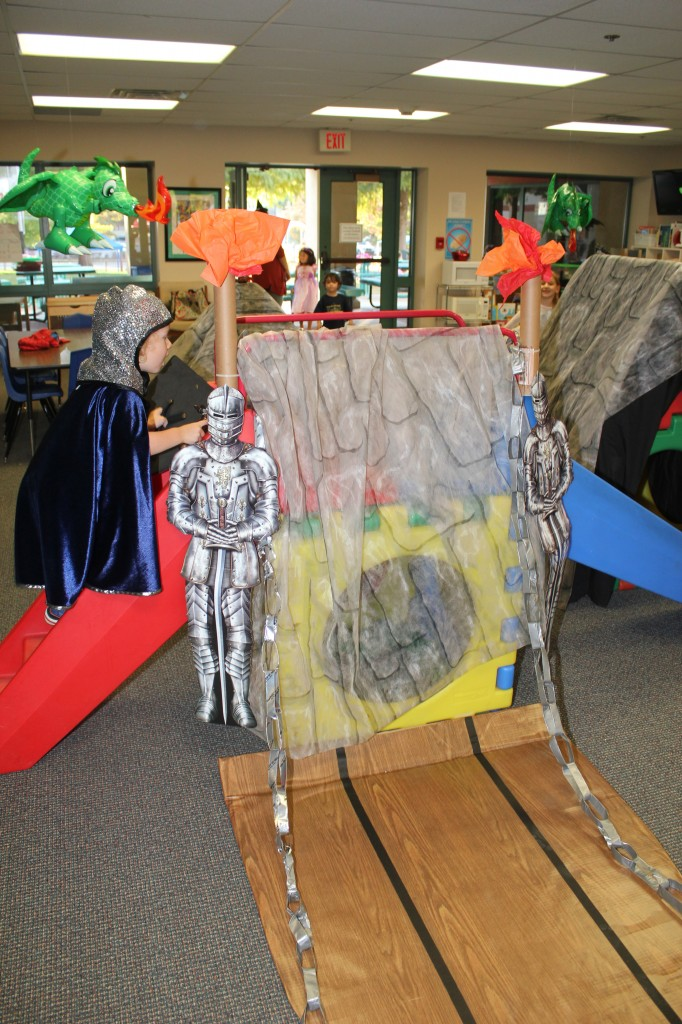 Drawbridge, knights, and torches =)  Turning the play structure into a castle was FUN!  I love the dragons flaming the castle.