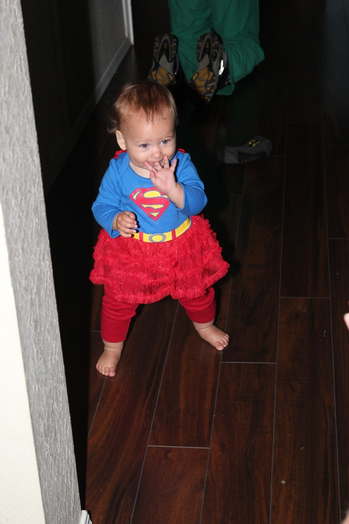 Super Girl kept trying to crawl out the door every time we got trick-or-treaters.  She got as far as the welcome mat.  It was too prickly to want to touch =)