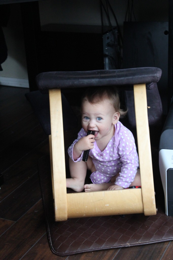 Eating her favorite piece from the tool puzzle in her favorite hideout, under Daddy's desk chair.