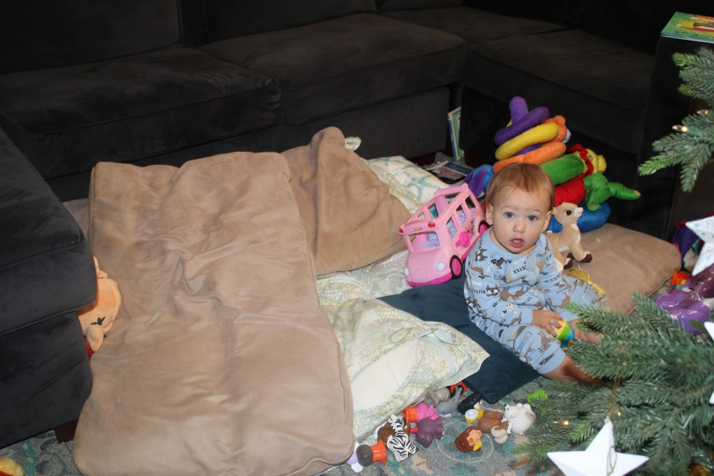 "One day the kids made ""Baby Paradise""  They covered the floor with cushions and piled the baby toys high.  They also blocked Maia in with cushions but she didn't mind as long as they were with her =)"
