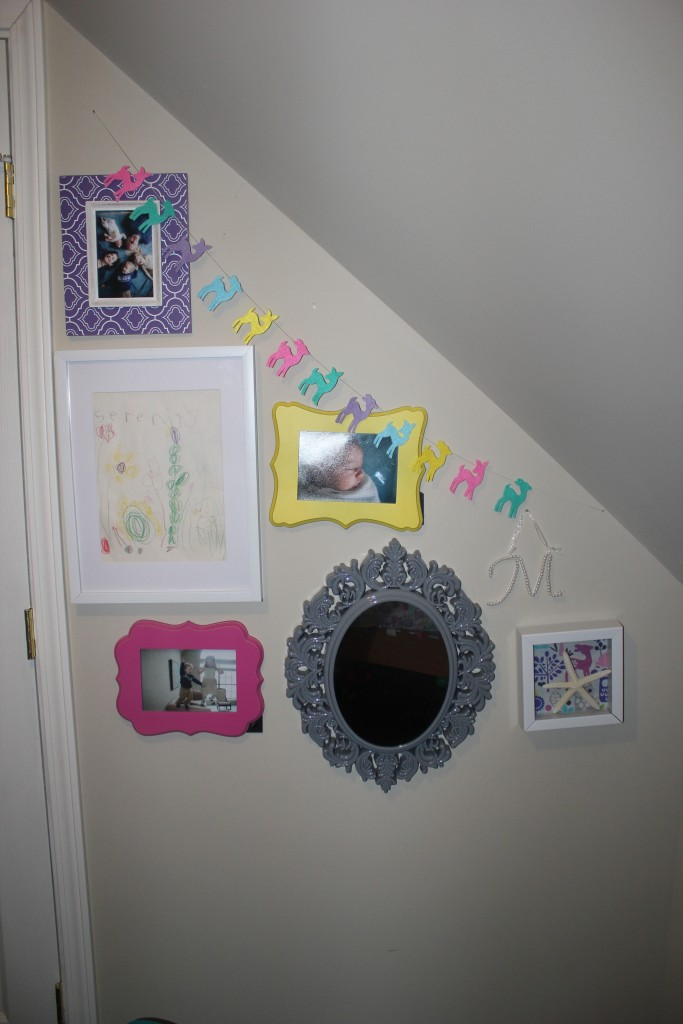 Serenity's butterfly garden drawing , a starfish, a mirror low enough for her to look in, and some family pictures =)