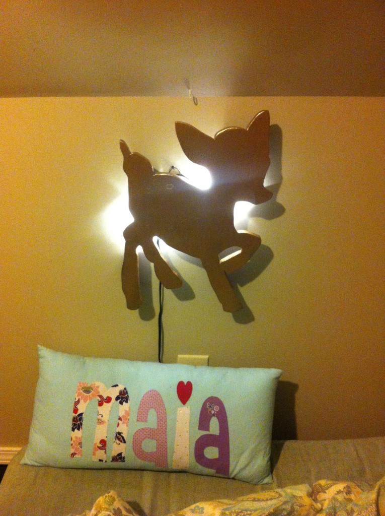 I've been working on changing the nursery from DZ's monkey decor to Maia's deer room =)  Papa made her this deer lantern!