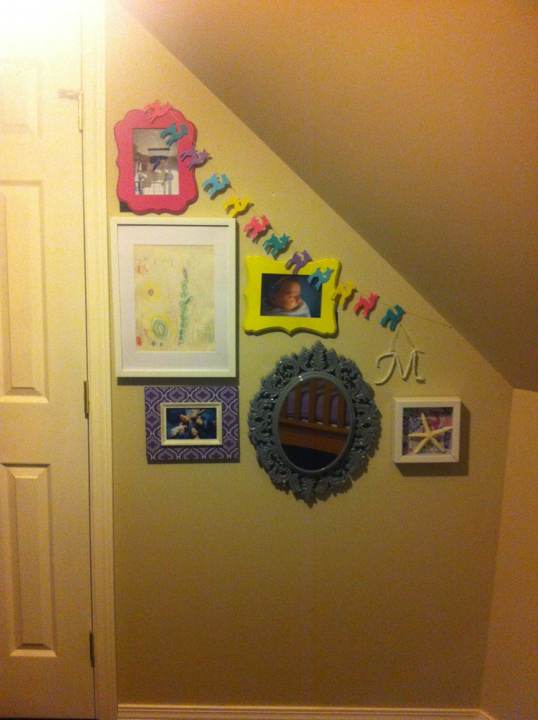 I moved some of her pictures upstairs as well.  Still some more to do though!