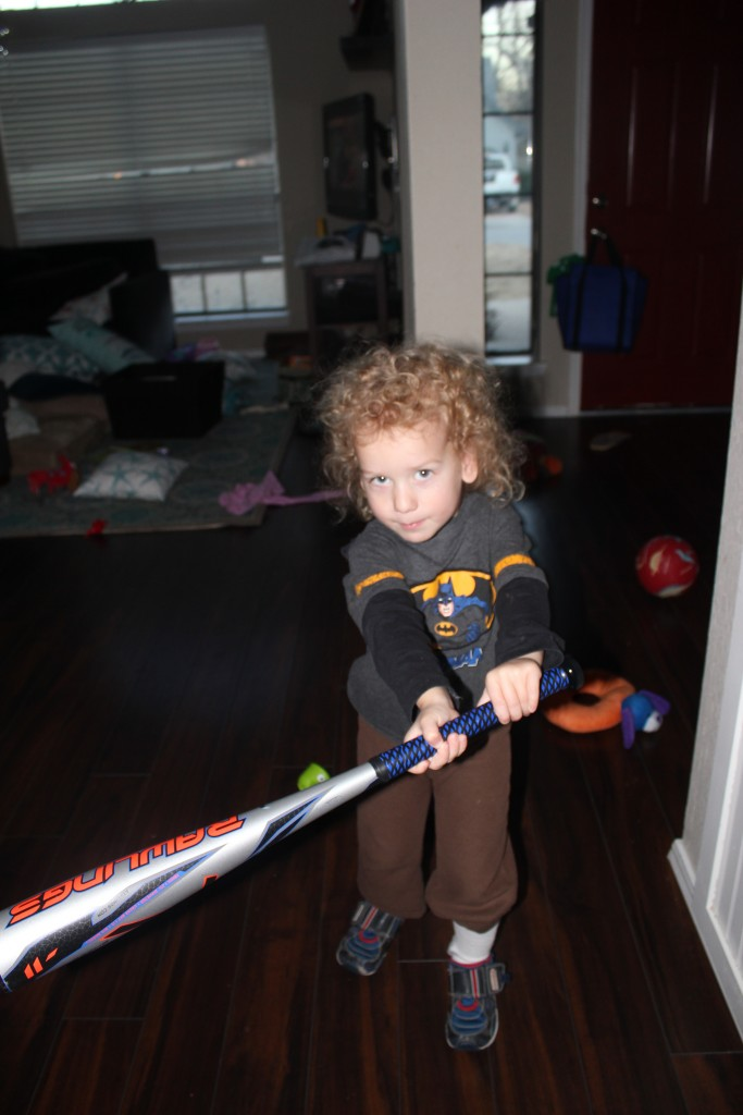 DZ wants to play baseball for his Spring activity, and since we haven't been able to find a team for his age group, he's going to have a baseball class with Daddy!  He chose this bat! =)
